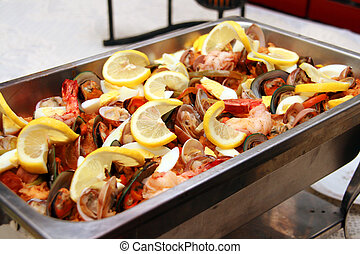 seafood paella served with lots of lemon toppings