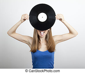 Girl with vinyl disc, isolated on white