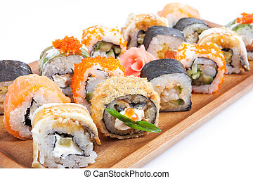 Sushi and rolls on the plate
