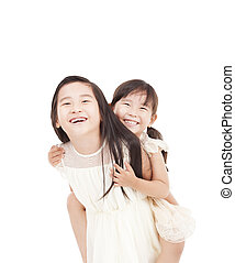 happy two little girls isolated on the white background