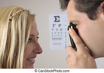 Eye Checkup - Closeup of a an optometrist eye doctor...