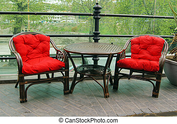 Red chairs outdoor with table