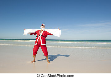 Santa Claus Christmas Beach Swim - Santa Claus standing with...