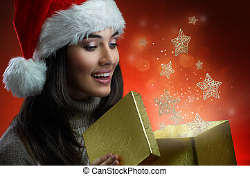Christmas presents - the girl in a hat with a gift