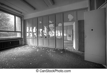 abandoned empty office rooms with broken windows