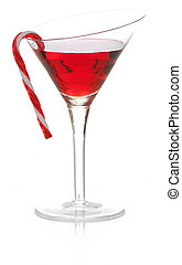 christmas cheer - colorful cocktail with candy cane on the...