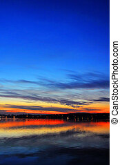 Sunset over lake - Magnificent sunset over a lake with...