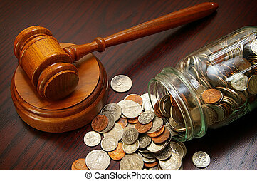 legal coins - legal gavel and coins in a coin jar