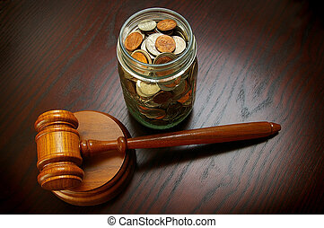 gavel money - legal gavel with coins in a jar