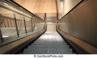 Descending escalators and stairs - Escalator of the subway...