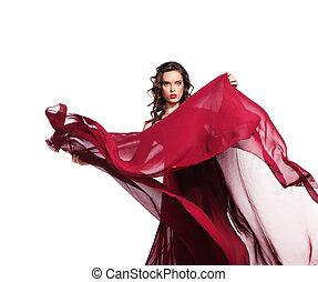 Dancing woman in red dress flying on wind