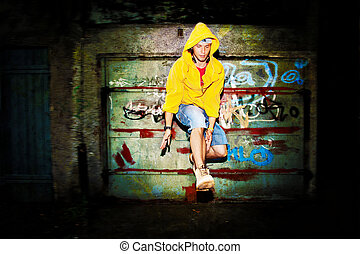 Young man jumping on grunge wall - Young man jumping /...