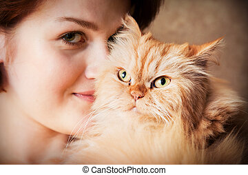 Young woman with Persian cat portrait - Young woman with...