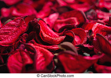 Spa background of dried petals of red roses - symbol of love...