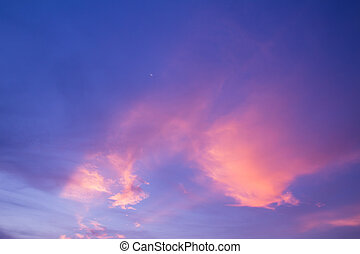 Half moon,pink cloud and blue sky at dusk