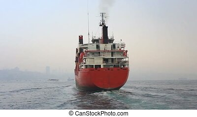 Red cargo ship  - Back view of the cargo container ship.