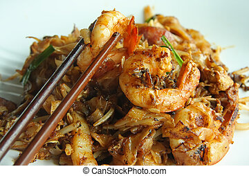 Fried asian noodles - Fried flat rice noodles traditional...