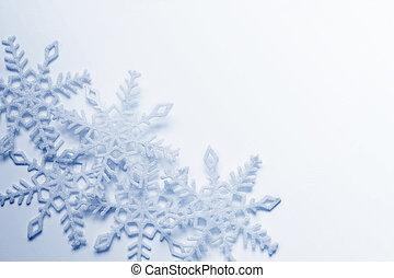 Snowflakes background - Blue and white snowflakes on a blue...
