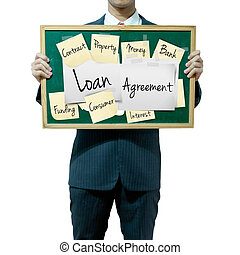 Business man holding board on the background, Loan Agreement