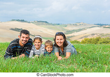 Happy family having fun outdoors in Tuscan - Happy family...