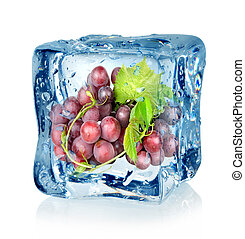 Ice cube and blue grapes isolated on a white background