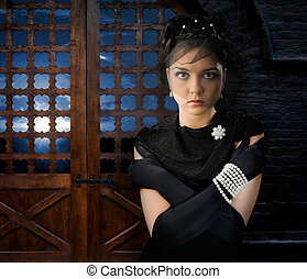 Woman in Castle - Woman on backdrop of antique wooden doors