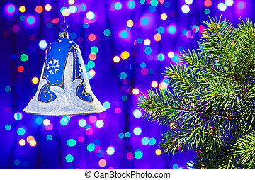 Christmas  decorations bell on multicolor circles bokeh background