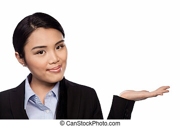Asian businesswoman holding out her palm - Smiling Asian...