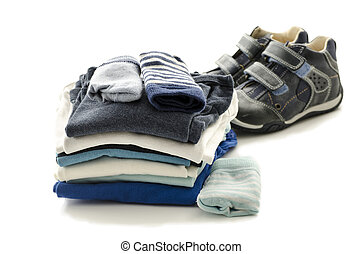 Baby clothes and shoes isolated on a white background.
