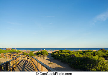 Scenic beach - Scenic footbridge on idyllic Carabassi beach,...