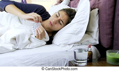 Sic woman in bed with flu - woman with fever in bed takes...