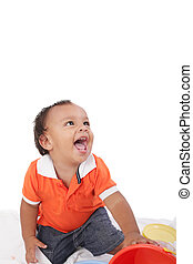 Adorable 1 year old hispanic boy with a big smile looking up