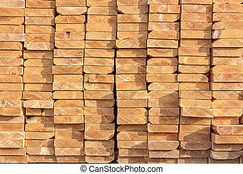 Stacked Lumber at Construction Site - Lumber is Stacked and...