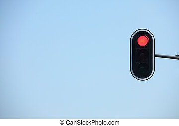 Red traffic lights against blue sky backgrounds