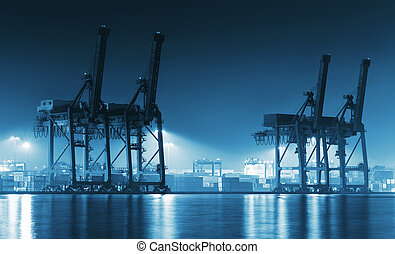 port - Container Cargo freight ship with working crane...