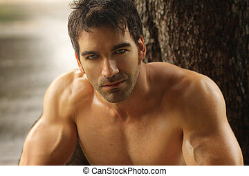 Hot guy - Sexy masculine man shirtless outdoors against tree