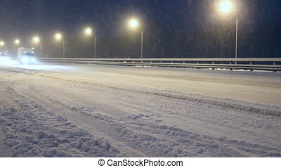 Winter highway. Snow, blizzard, cars