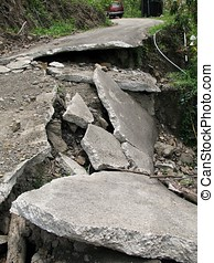 Broken Road - -- a narrow road destroyed by an earthquake or...