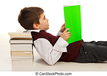 Student boy reading book - Student boy resting head on stack...