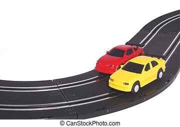 Slot Cars - Two slot cars racing on a track.