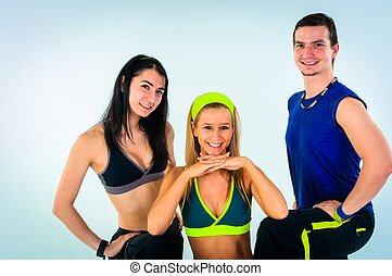 group of proud fitness instructors on white background