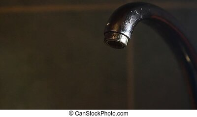 Water flows from the tap