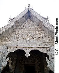 White molding art on temple gate in Traditional Thai style...