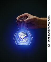 Earth in a bottle - Man holding an old bottle with a glowing...