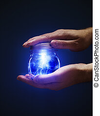Jar of Lightnings - Conceptual image of a man holding a jar...