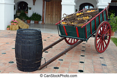 cart and barrel in front of house - antique wood cart with...