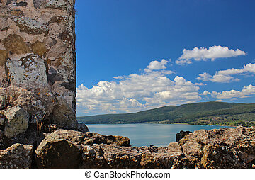 Ruins in the sky 2 - A beatiful lake scenery framed by an...