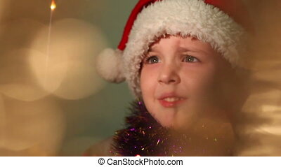 little boy dressed as Santa Claus, soft focus