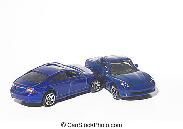 Car Wreck - A car wreck involving two miniature toy cars.