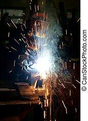 Welding - Worker welding in a mechanical workshop
